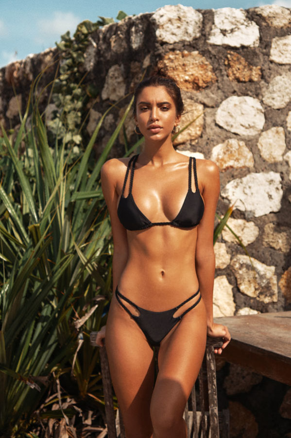 Our pretty bikini set featuring a classic sold black color in a minimal coverage triangle style.